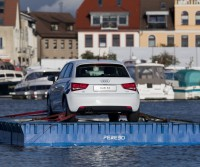 car on a floating platform