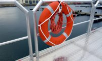 removable antifall guard on workboat deck