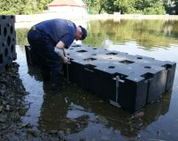 assembly of plastic pontoons in shallow water