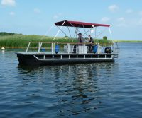 recreational pontoon boat with sun sail